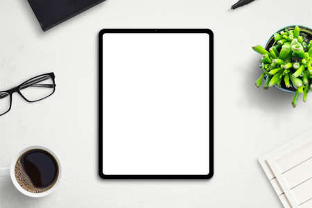 Tablet mockup on office desk. Isolated screen for app or web site design promotion. Top view, flat lay