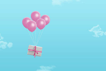 Gift delivery at Christmas corona time with the help of balloons. Minimal concept with pastel colors