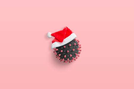 Coronavirus with Santa Claus hat concept