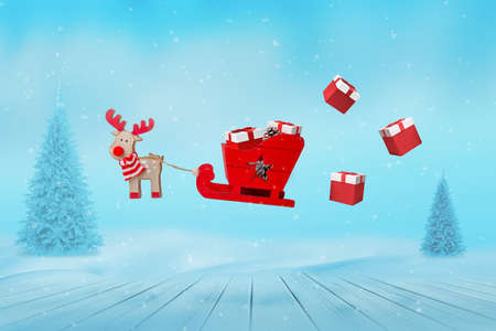 Deer with sledge and flying Christmas gifts concept 版權商用圖片