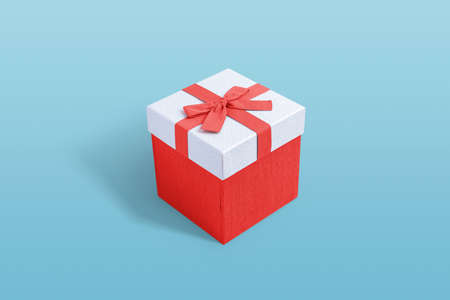 Red Christmas gift box on blue background