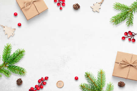Cute Christmas background with gifts, branches and decorations. Free space in the middle for greeting text 版權商用圖片