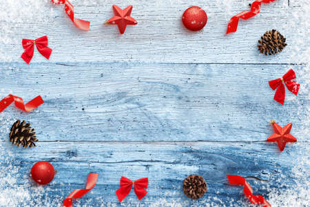 Christmas background with decorations on blue wooden table. Top view, flat lay composition