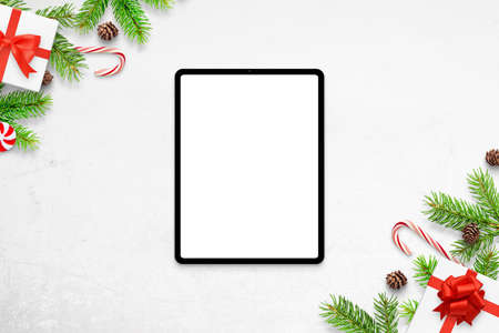 Tablet mockup on white desk with Christmas decorations. Top view, flat lay composition 版權商用圖片