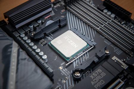 Sarajevo, Bosnia and Herzegovina - December 29, 2020: New fifth-generation Ryzen 5900x processor in the motherboard socket
