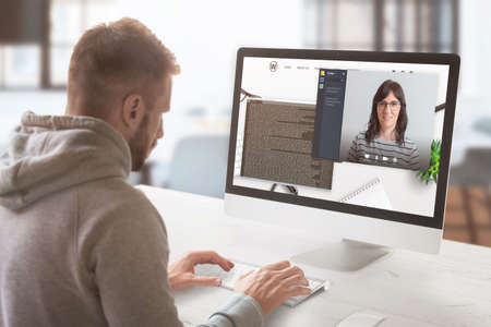 Freelancer communicates with the employer online. Work desk with modern computer. Work at home  concept.