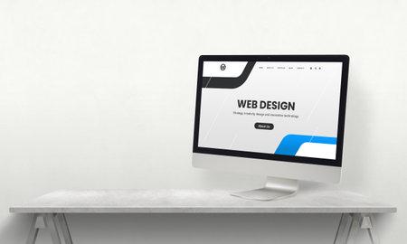 Web design studio desk with computer display and promo web page on it. Development team promotion concept 版權商用圖片