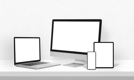 Display mockups for responsive web page design promotion. Laptop, computer display, phone and tablet on desk