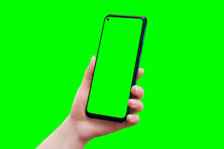 Phone mockup in woman hand isolated in chroma key green. Soft retouched woman hand 版權商用圖片