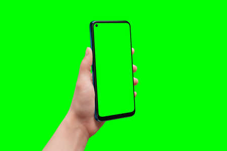 Phone in man hand with isolated background and display for app design presentation. Isolated in chroma key green