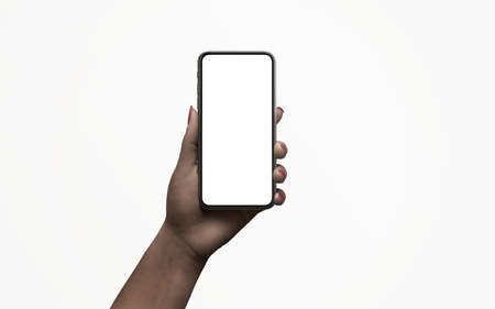 Isolated phone in hand with low, night light. Dark skin. Isolated display for app design promotion