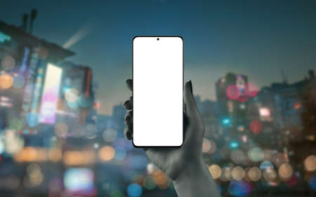 Phone mockup in woman hand with city lights in background
