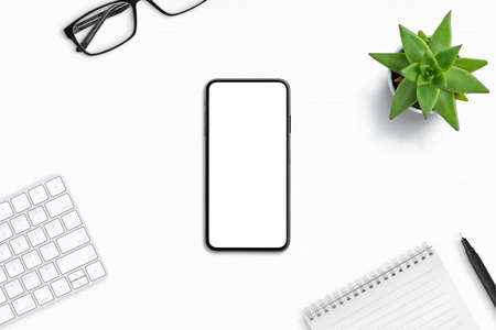 Phone mockup on office desk composition. Isolated screen for app design promotion Фото со стока