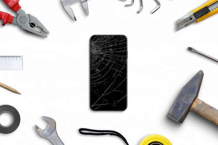 Repair broken phone display concept. Work desk with tools. Top view, flat lay