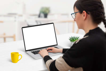 Woman work on laptop computer with isolated screen for web site promotion Фото со стока