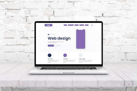 Laptop computer with web page layout. Concept of web and graphic design studio