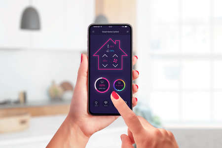 Smart home control app concept on modern phone in woman hands