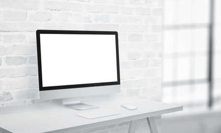 Coputer display on office desk with isolated screen in white for app or web page presentation mockup Фото со стока