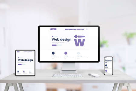 Responsive web desing studio page promotion on tablet, computer display and smart phone. Creative web page concept. Clean office desk with devices
