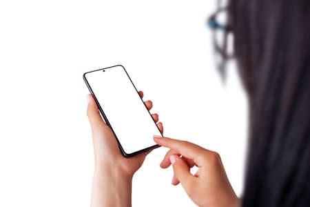 Modern phone mockup in woman hands. Over shoulder view. Isolated background.