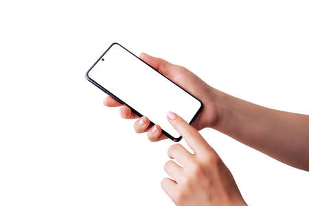 Woman holds a mobile phone and touch display. Isolated hands and phone screen for mockup, app design presentation. Soft retouched hands skin