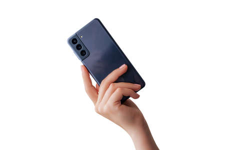 Woman hand shows a modern phone with three cameras on the back. Isolated background Фото со стока