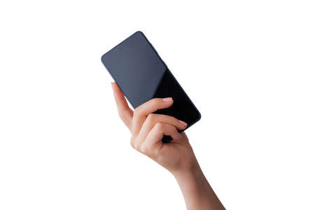 Softly retouched hand shows a smart phone with an isolated screen and background. Modern phone with built-in screen camera