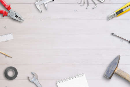White wooden desk with tools. Handyman desk with free space for promo text Фото со стока
