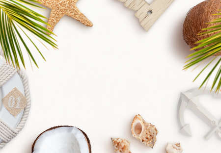 Summer, travel, beach composition with palm leaves, starfish, shells, coconuts, lifebelt and anchor. Top view, flat lay composition with copy space in the middle