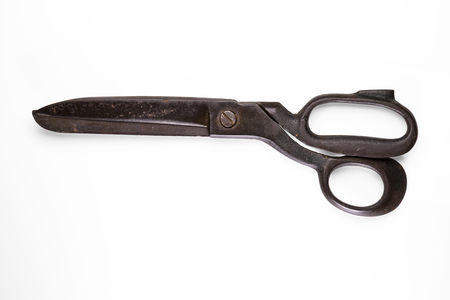 Old rusty scissors isolated on white background with clipping path