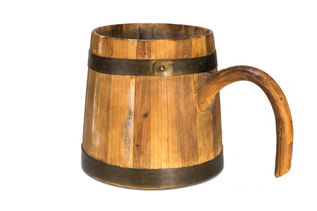 Old traditional wooden mug isolated on white background