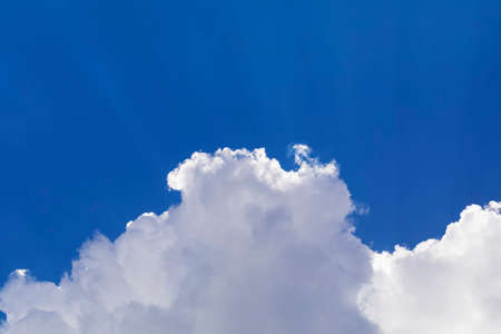 Dramatic white clouds float in the blue sky. Stockfoto