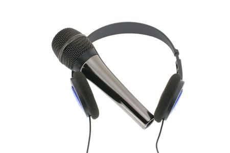 Microphone with headphones isolated on a white background photo