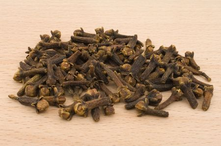 Heap of a  cloves laying on a kitchen board photo