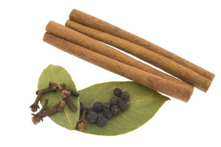 curative: Such seasoning as: cinnamon, pepper, a carnation and a bay leaf isolated on white