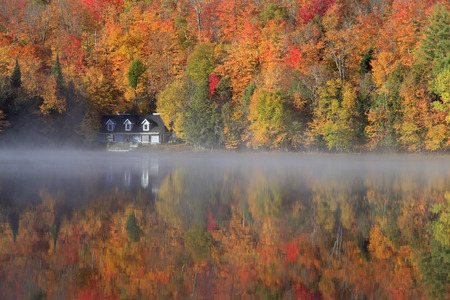 mountin: Autumn colors and fog reflections on the lake, Quebec, Canada Editorial