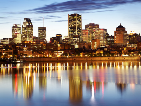 lawrence: Montreal skyline at dusk and colorful reflections in Saint Lawrence River Stock Photo
