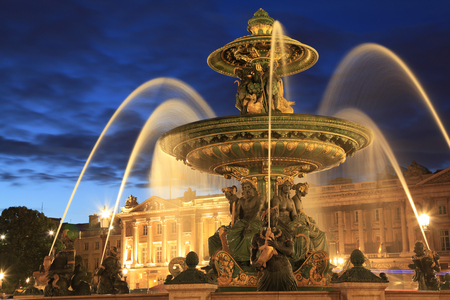 Fountain in Place de la Concorde at dusk in Paris, France