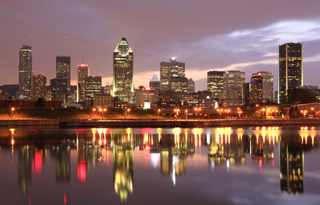 Montreal skyline at dusk and reflections on Lachine Canal in Quebec, Canada