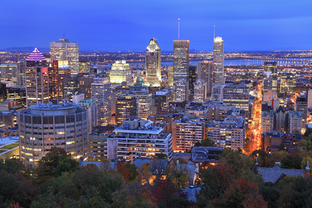 Montreal skyline illuminated at dusk in autumn, aerial view 免版税图像