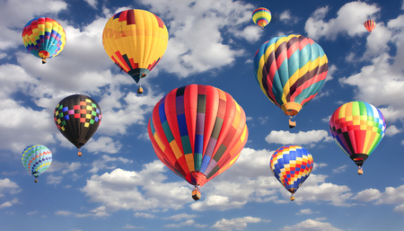 air: Multicolored hot air balloons flying Stock Photo