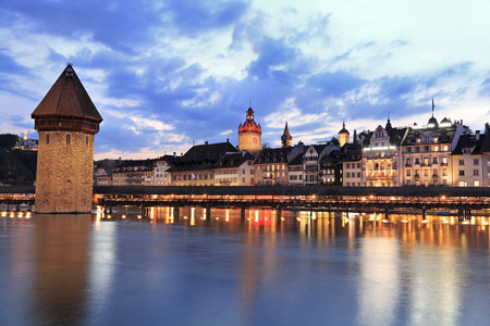 swiss culture: Chapel Bridge and Lucerne skyline at dusk, Switzerland