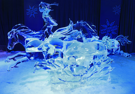 ice sculpture: Ice sculpture of rider and horses, illuminated at night in Confederation Park, Winterlude Event, Ottawa