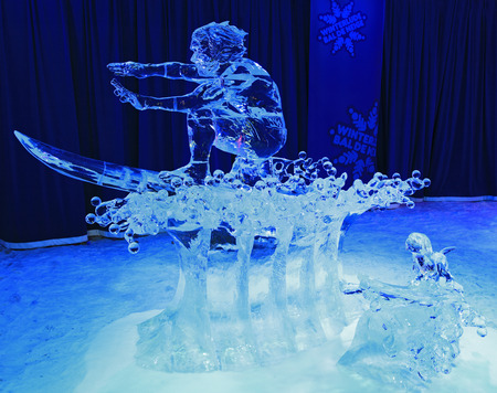 ice sculpture: Ice sculpture of surfer, illuminated at night in Confederation Park, Winterlude Event, Ottawa Editorial