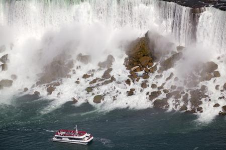 american falls: American Falls and cruise boat, Niagara, Canada Stock Photo