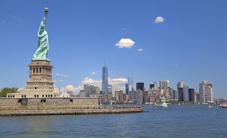 liberty island: Statue of Liberty and New York skyline Stock Photo