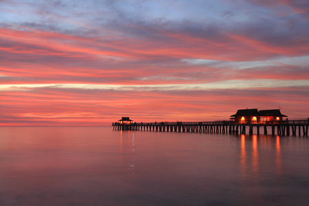 sunset clouds: Naples Pier at sunset, Gulf of Mexico, USA