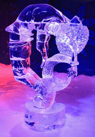 ice sculpture: Ice sculpture of dragon and girl, illuminated at night in Confederation Park, Winterlude Event in Ottawa, ON, Canada Editorial