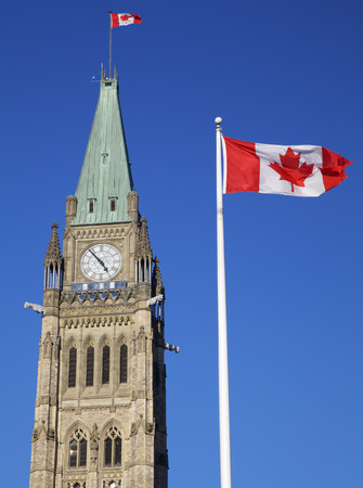 canadian flag: Canadian Flag and Peace Tower Stock Photo