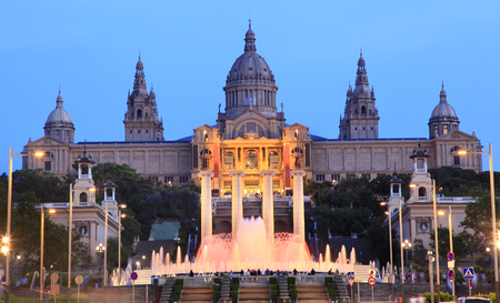 nacional: Museu Nacional dArt de Catalunya and Magic Fountain illuminated at dusk, Barcelona, Spain Editorial